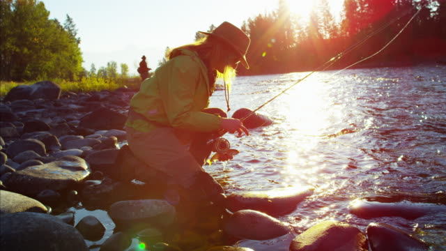 Female fisherman with catch of Cutthroat Trout Canada