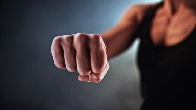 slo mo ld female fist pulling back - fist stock videos & royalty-free footage