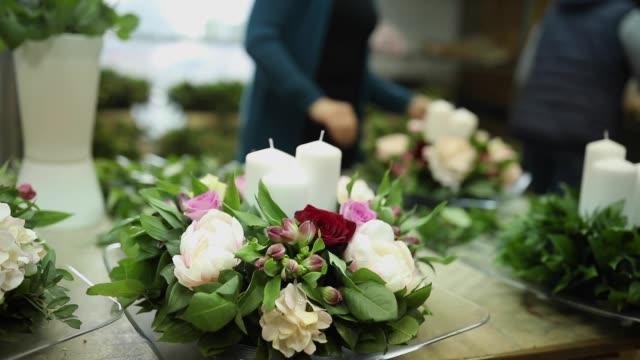 female florist arranging flowers - flower arrangement stock videos & royalty-free footage