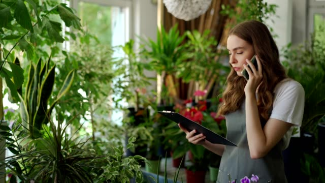 female florist receives orders by the phone - flower shop stock videos & royalty-free footage