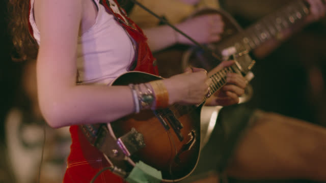 female folk musicians play mandolin and acoustic guitar together on stage - country and western stock videos & royalty-free footage