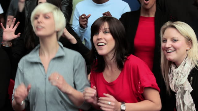female football fans cheering and hugging - encouragement stock videos & royalty-free footage