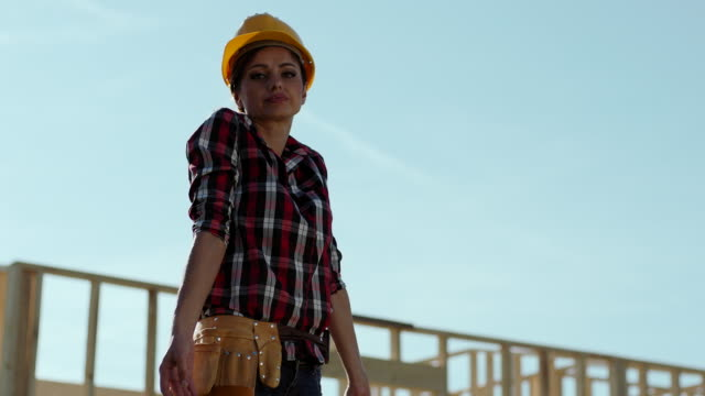 Female foreman doesn't understand blueprints at construction site
