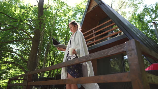 female freelancer working from a remote location - log cabin stock videos & royalty-free footage