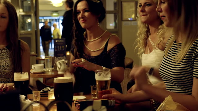 female friends at a pub - candid stock videos & royalty-free footage