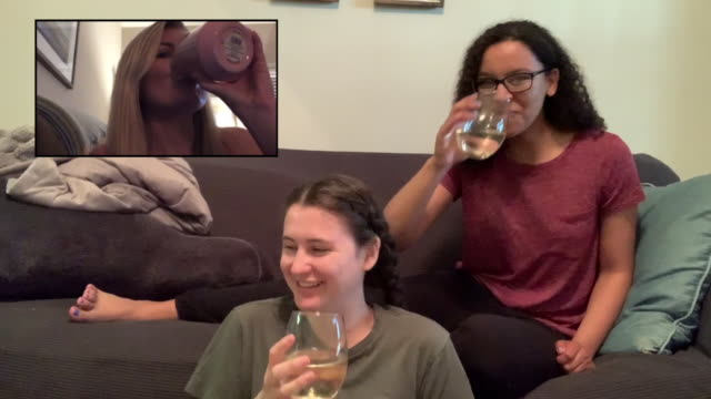 female friends chat during a virtual happy hour - happy hour video stock e b–roll