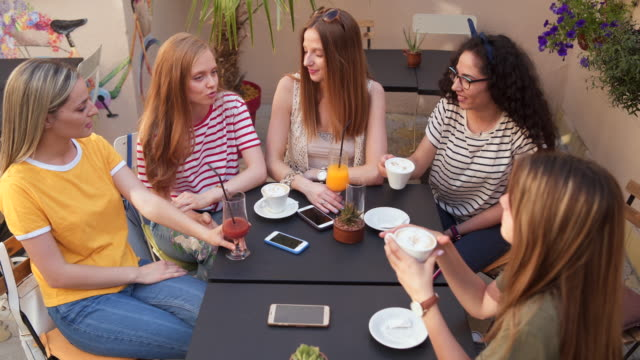 female friends drinking coffee in coffee shop - amicizia tra donne video stock e b–roll