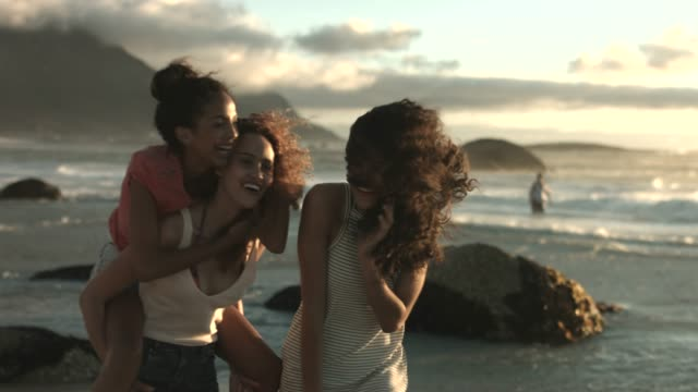 female friends enjoying at windy beach - youth culture stock videos & royalty-free footage