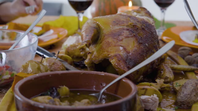 female  friends  having thanksgiving lunch - roast turkey stock videos & royalty-free footage
