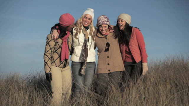 female friends in a field, singing and swaying - woolly hat stock videos and b-roll footage