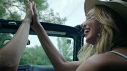 Female friends on road trip. High five
