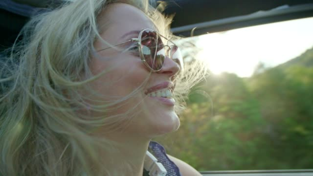 female friends on road trip - sun roof stock videos & royalty-free footage