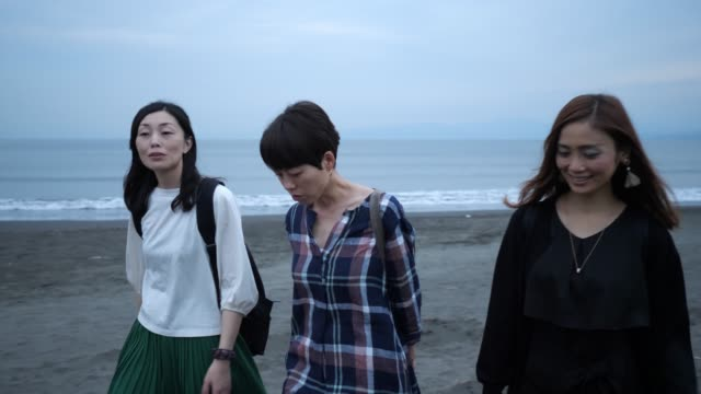 female friends walking on the beach at sunset time - only japanese stock videos & royalty-free footage