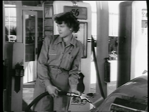 b/w 1944 female gas station attendant pumping gas at 76 station / industrial - gas station attendant stock videos and b-roll footage