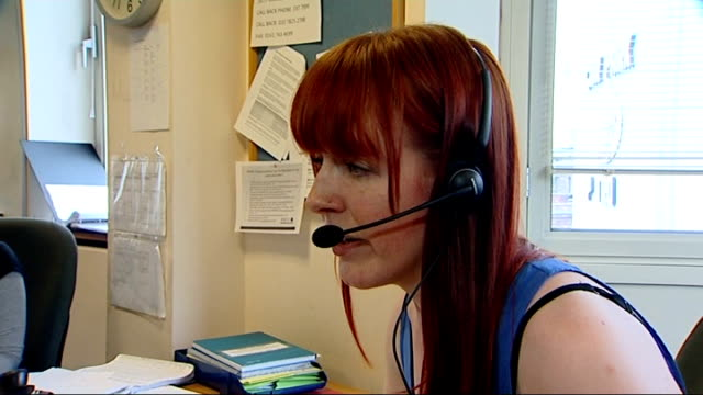 Female genital mutilation hotline launched by NSPCC ENGLAND INT Woman with headset speaking to NSPCC helpline caller SOT 'FGM Helpline' poster Woman...