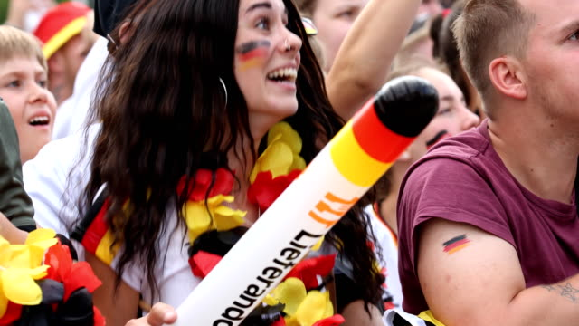 a female german fan is jumping hopefully high and finally is disappointed during germany is loosing the 2018 fifa world cup russia group f match... - fifa world cup 2018 stock videos & royalty-free footage