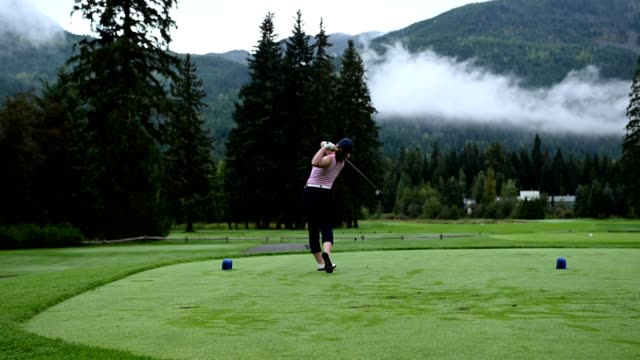 female golfer making the drive - hitting stock videos & royalty-free footage
