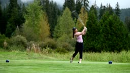 Female golfer making the drive