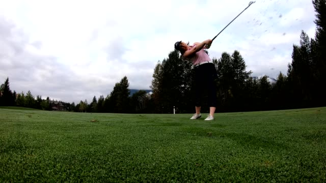 female golfer making the drive - golfer stock videos & royalty-free footage