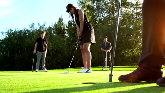 Female golfer shoots for the target