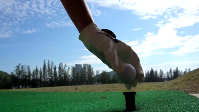 female golfer, slow motion - teeing off stock videos & royalty-free footage