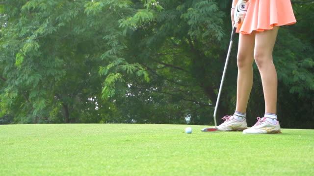 female golfer, slow motion - golfer stock videos & royalty-free footage