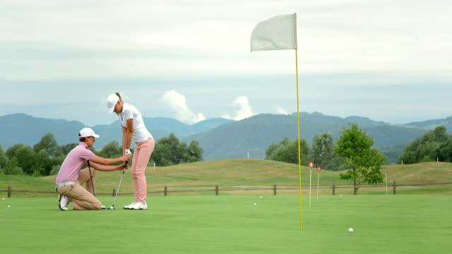 HD DOLLY: Female Golfer Taking Lessons