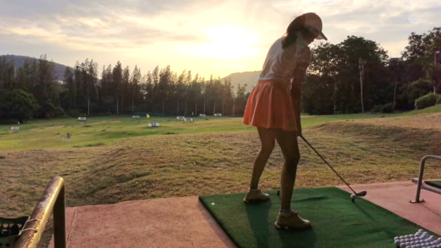 female golfer teeing off, time lapse - golf swing women stock videos & royalty-free footage