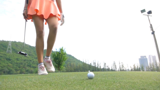 slo mo female golfer teeing off - golf swing women stock videos & royalty-free footage