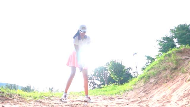 slo mo female golfer - golfer stock videos & royalty-free footage