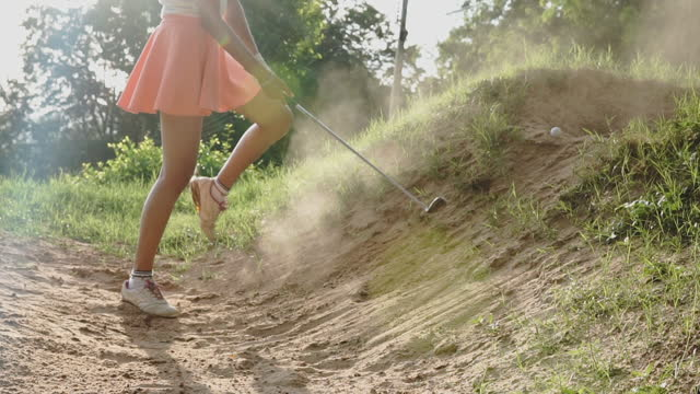female golfer with golf swing against - golf swing silhouette stock videos & royalty-free footage