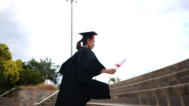 a female graduation running slow motion - diploma stock videos & royalty-free footage