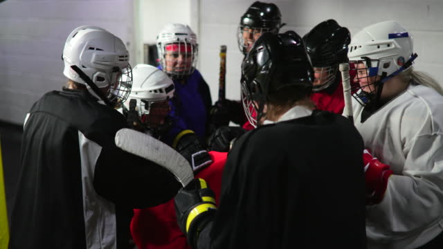 Female Group of Ice Hockey Players Chanting Before Their Big Game