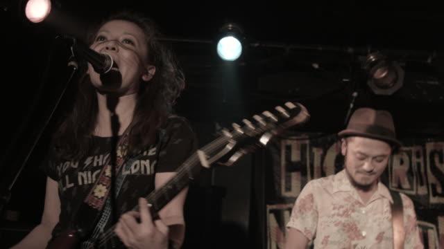 MS PAN Female guitarist singing on stage / Nakano, Tokyo, Japan