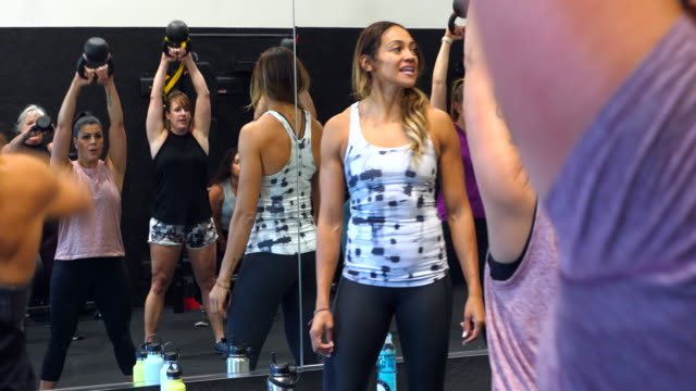 ms female gym owner giving instructions to fitness class - pacific islanders stock videos & royalty-free footage