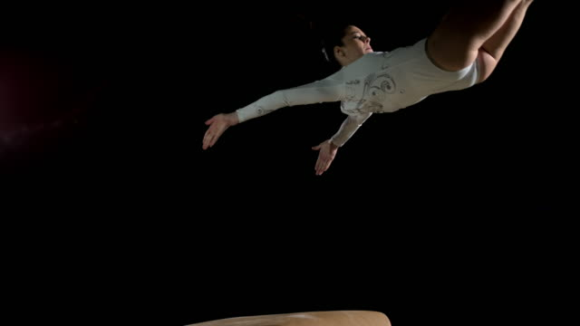 slo mo female gymnast doing a front handspring on the vault - gymnastics stock videos & royalty-free footage