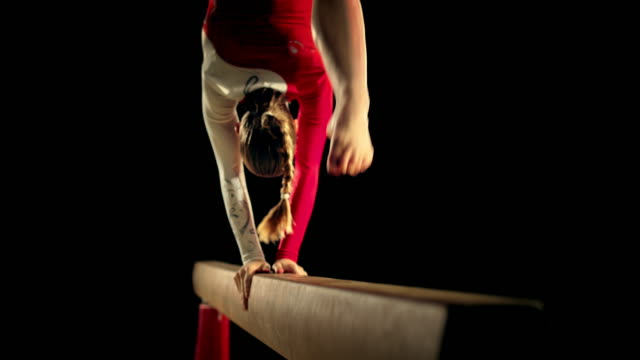 slo mo ld female gymnast on the balance beam - gymnastics stock videos & royalty-free footage