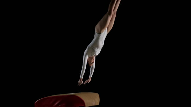 slo mo ds female gymnast performing a back handspring on the vault - gymnastics stock videos & royalty-free footage