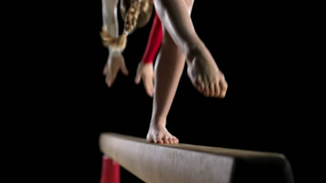 slo mo female gymnast's legs while performing a back walkover - leotard stock videos & royalty-free footage