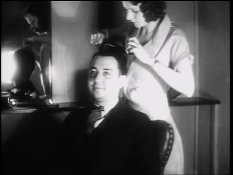 b/w 1931 female hairdresser cutting man's hair in beauty shop / toledo, ohio / newsreel - 1931 stock videos & royalty-free footage