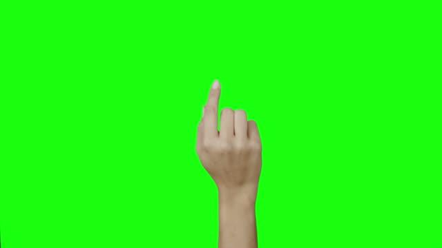 vidéos et rushes de femme main geste - fond coloré