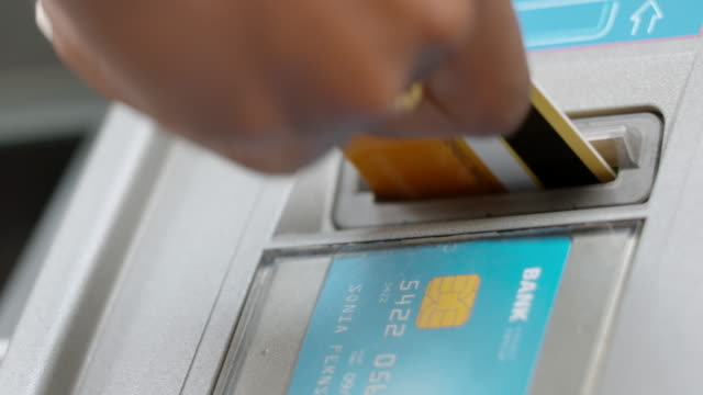 female hand inserting a gold card into an atm - inserting stock videos & royalty-free footage