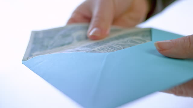 slo mo female hand opening an envelope full of money - envelope stock videos & royalty-free footage