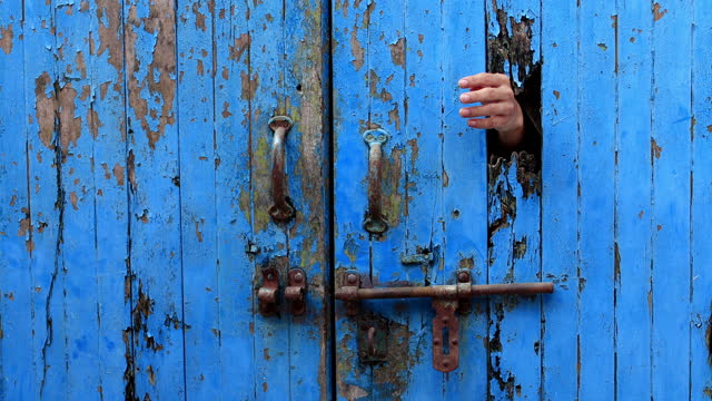 female hand opening wooden door - trapped stock videos & royalty-free footage