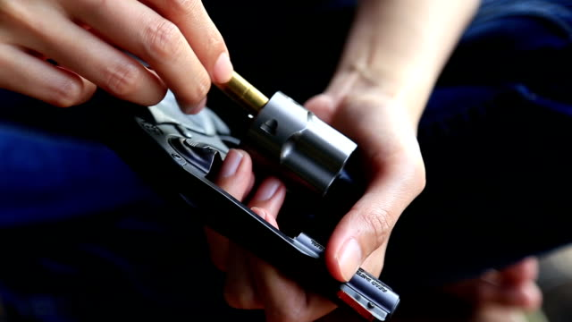 female hand reloading ammunition, revolvers - gun stock videos & royalty-free footage