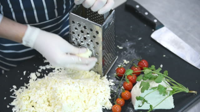 female hand rubs cook cheese on a grater - grater utensil stock videos & royalty-free footage