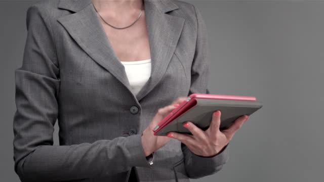 female hand touching tablet computer screen - tjänstekvinna bildbanksvideor och videomaterial från bakom kulisserna