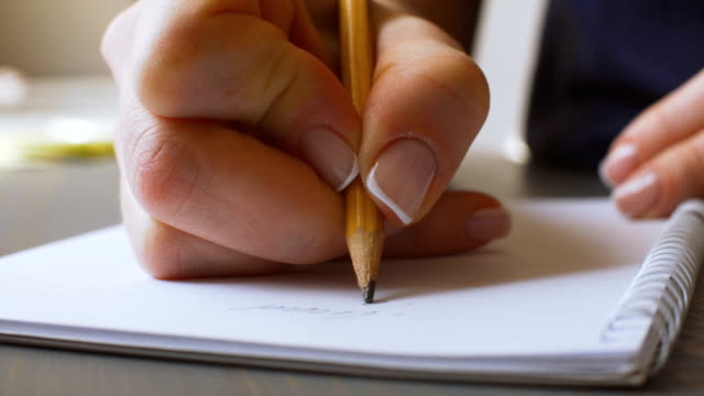 female hand writing on paper - list stock videos & royalty-free footage