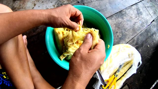 female hands are chopping bamboo shoots to prepare food. - vegetarian food stock videos & royalty-free footage