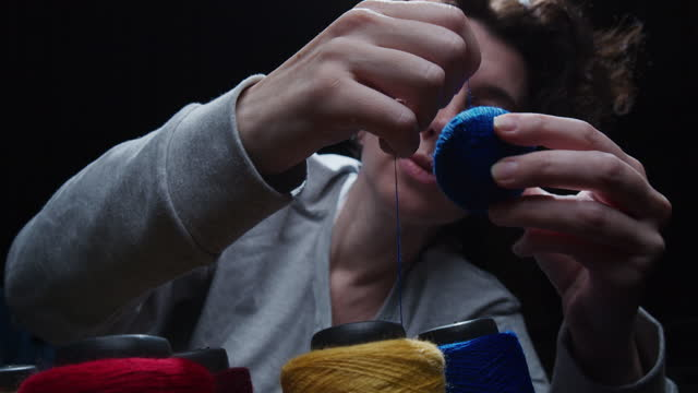 female hands are winding yarn up to a ball - ball of wool stock videos & royalty-free footage